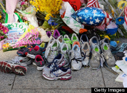 BOSTON, MA - APRIL 21:  Running shoes are placed at a makeshift memorial for victims near the finish line of the Boston Marathon bombings at the intersection of Boylston Street and Berkley Street two days after the second suspect was captured  on April 21, 2013 in Boston, Massachusetts. A manhunt for Dzhokhar A. Tsarnaev, 19, a suspect in the Boston Marathon bombing ended after he was apprehended on a boat parked on a residential property in Watertown, Massachusetts. His brother Tamerlan Tsarnaev, 26, the other suspect, was shot and killed after a car chase and shootout with police. The bombing, on April 15 at the finish line of the marathon, killed three people and wounded at least 170.  (Photo by Kevork Djansezian/Getty Images)